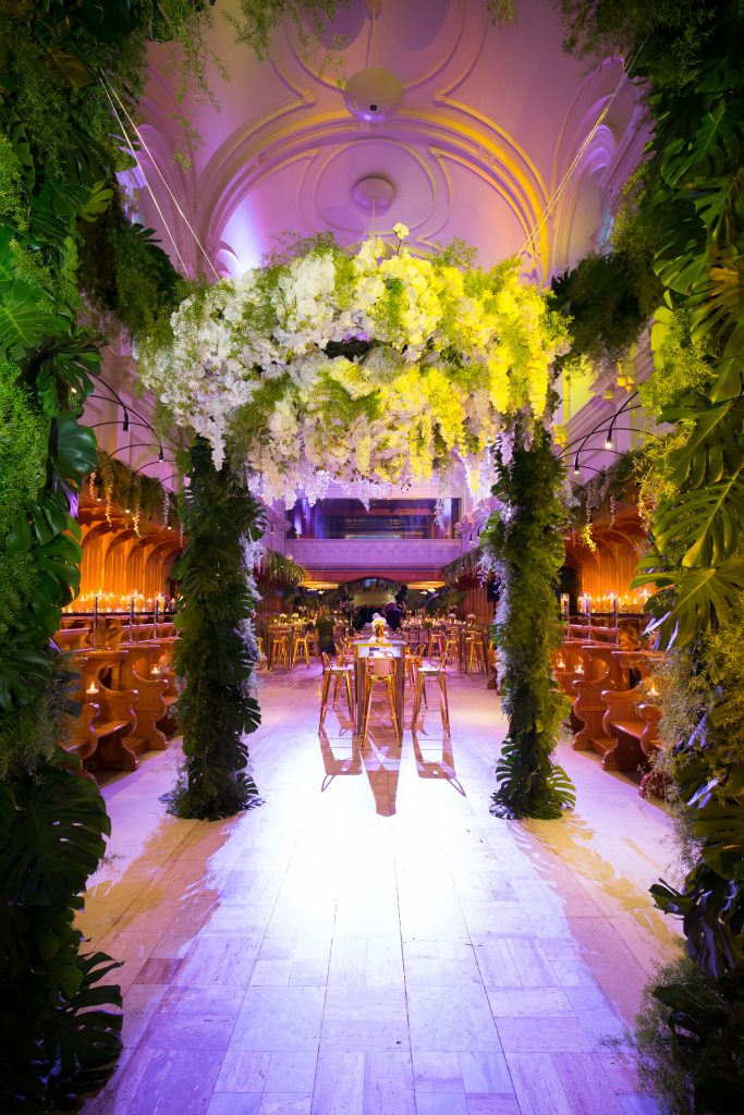 greenery huppah with orchids cascading down during reception wedding