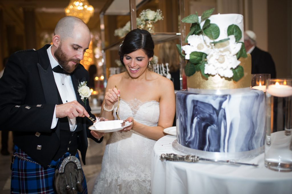 Photography by Christina Esteban Photography bride and groom on their wedding day eating wedding cake