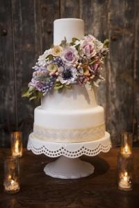 CEP Studio. Designer white wedding cake with flowers.