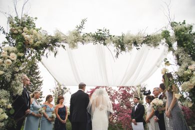 Outdoor wedding with flowers on hupah
