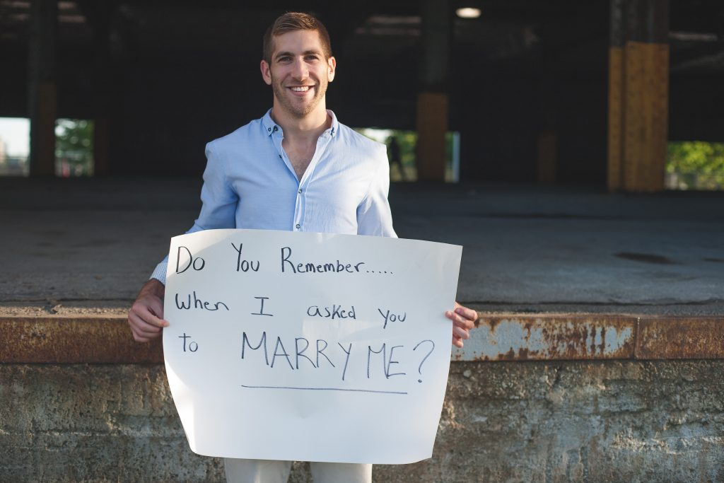 Montreal wedding photography groom holding up proposal
