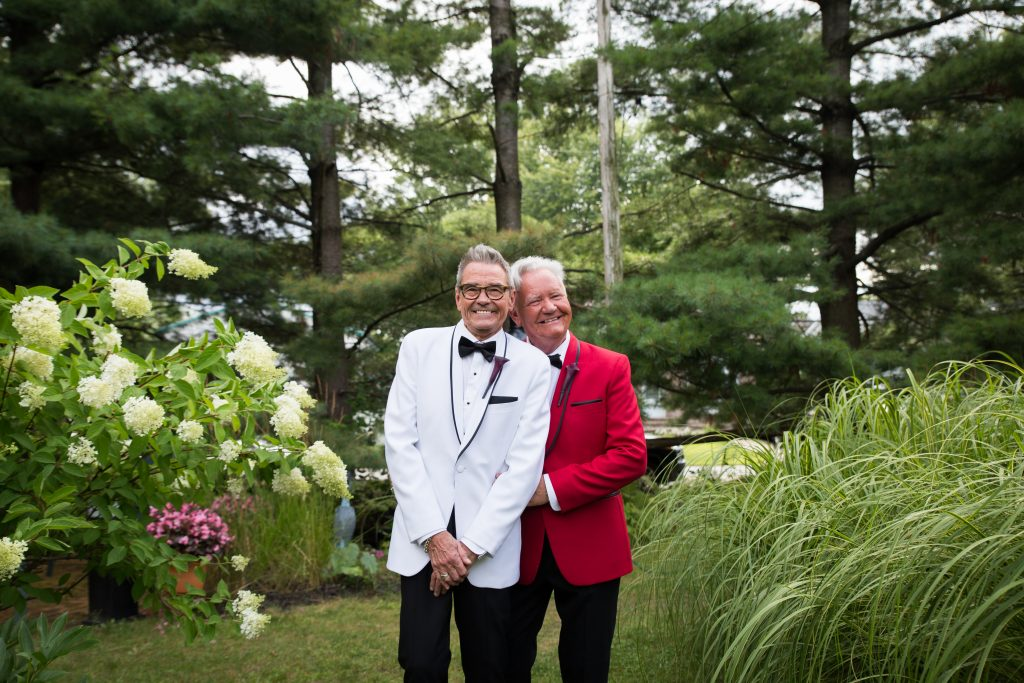 Same sex couple on their wedding day in the garden