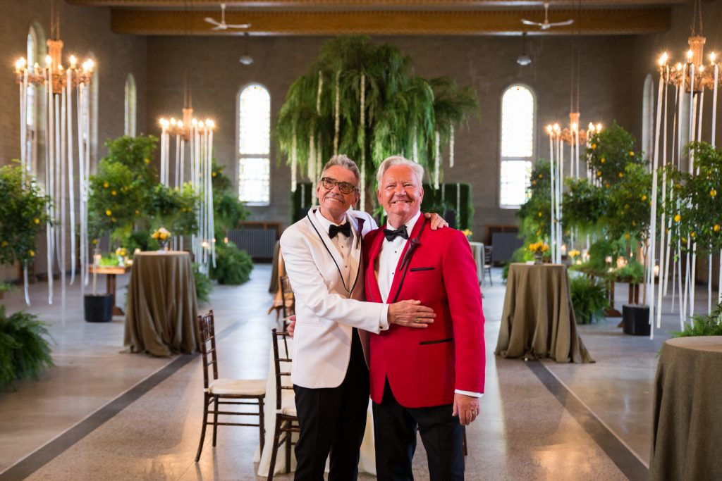 groom and groom standing at their wedding reception tuscan decor
