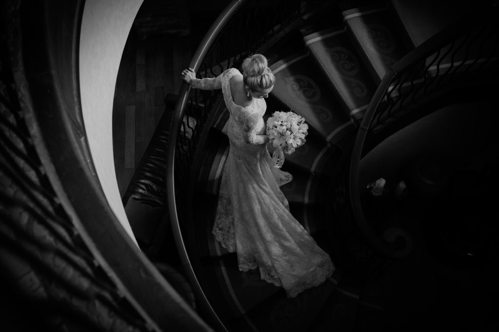 Montreal wedding photographer at hotel Quintessence black and white photo of a bride on the staircase