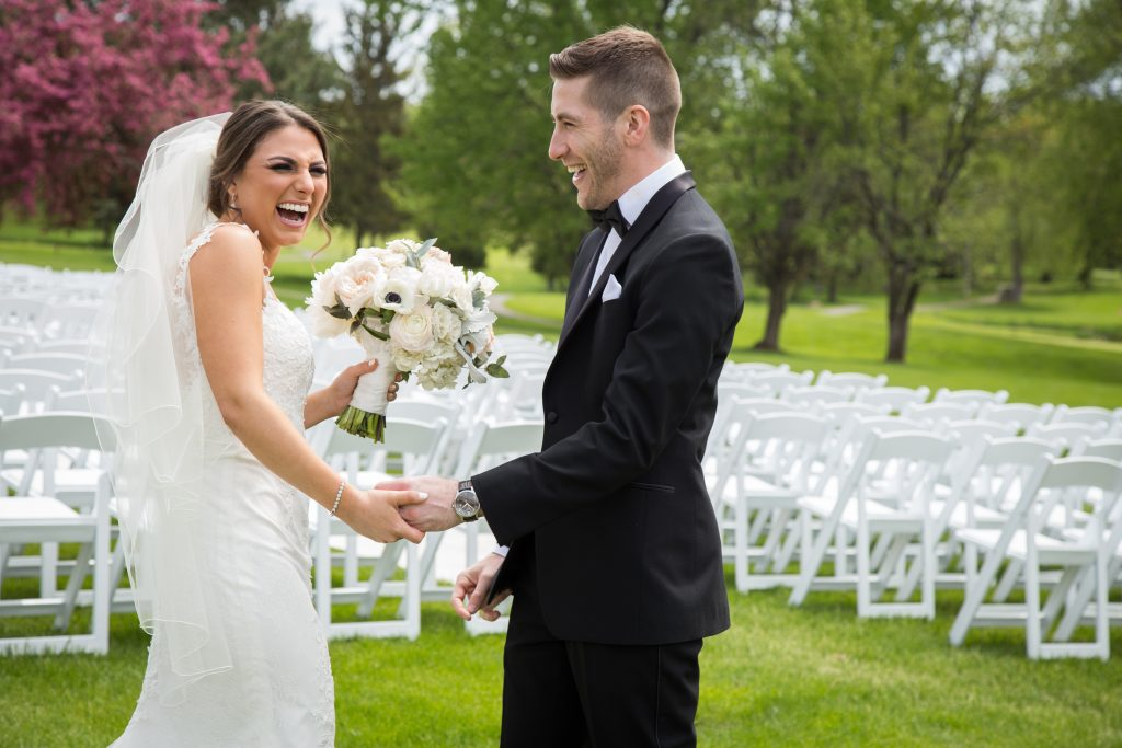 bride and groom first look outside at Elmridge Golf course