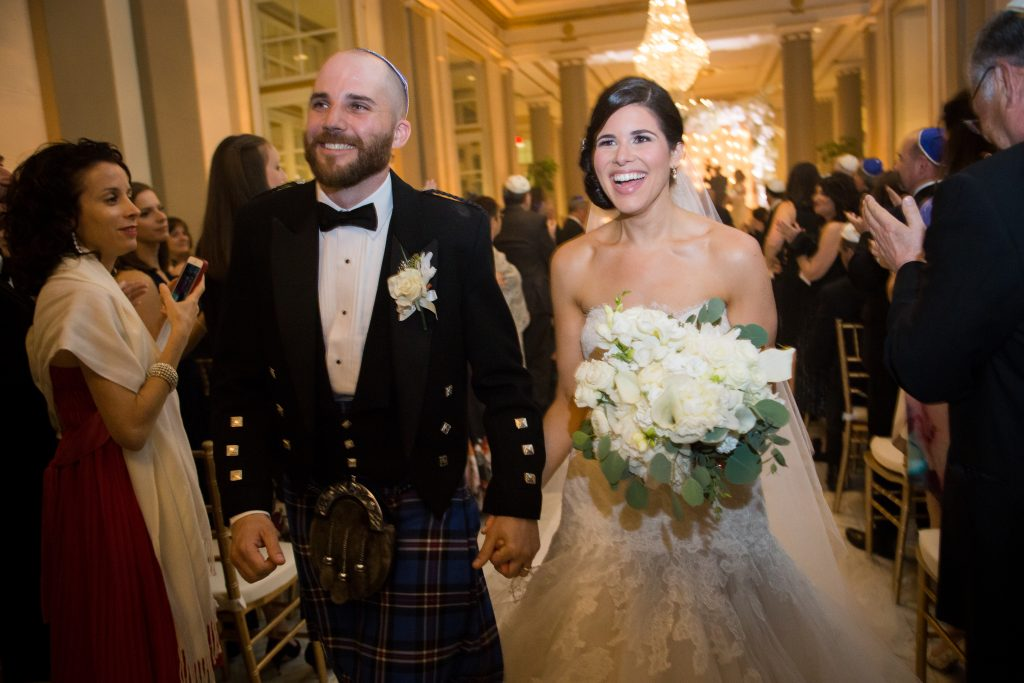 Wedding photographer Montreal: bride and groom walk down the aisle at the windsor.
