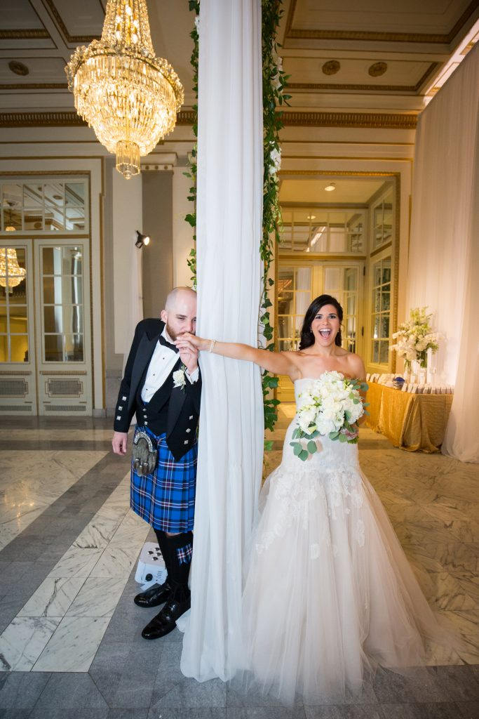 Montreal wedding photographer. Bride and groom divided between a curtain before they see eachother