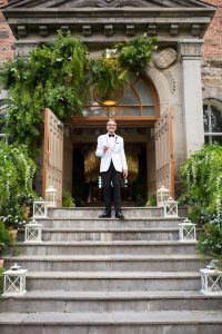 Groom standing at the top of staircase