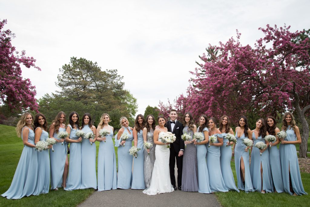 groom with all bridesmaids in blue dresses and bride with cherry blossoms surrounding them on their wedding day, Montreal