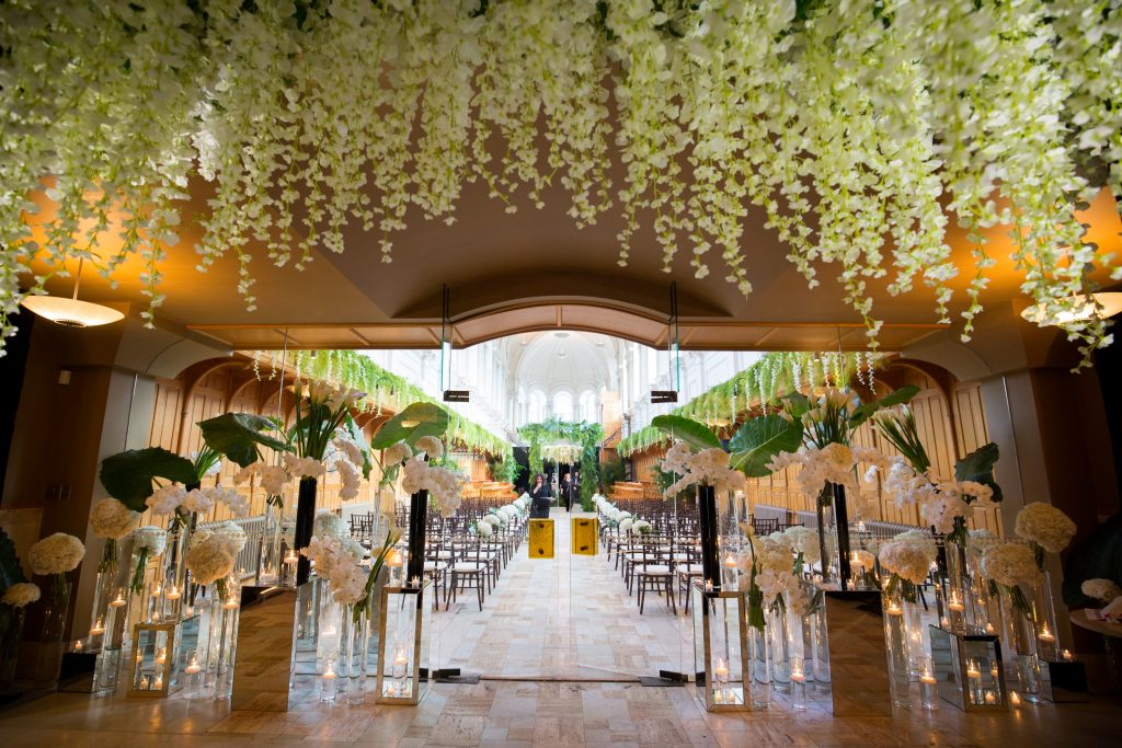Flowers cascading from the ceiling, flowers surrounding the entrance of the ceremony at abbaye, oka