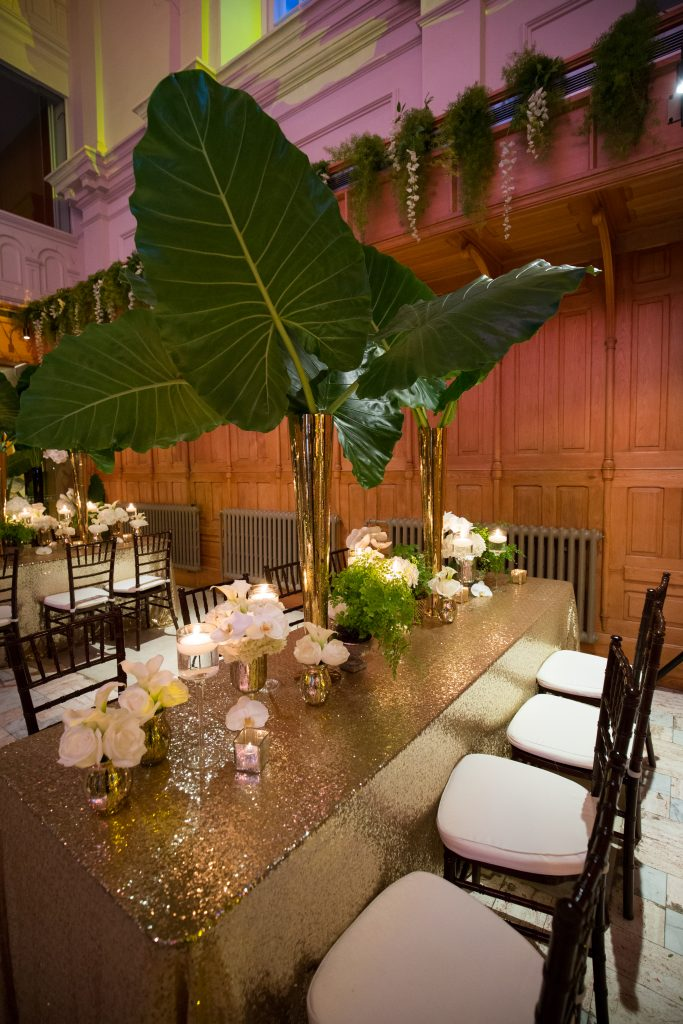 gold table cloth and greenery table decor