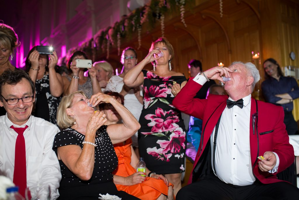 Guests with the groom doing shots at their wedding reception, Abbaye, d'OKA