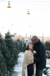 Montreal couple at Atwater market engagement photos with Christmas trees