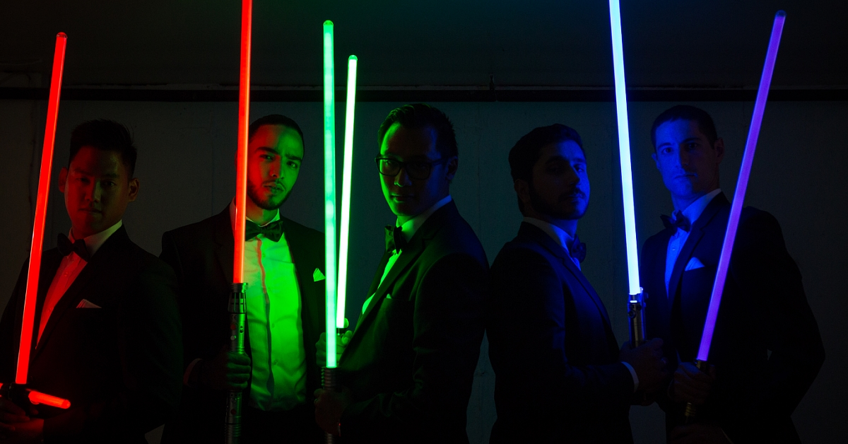 groom and groomsmen portrait with laser lighting